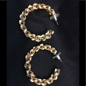 Gold tone knotted hoops